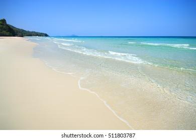 Sea and beautiful sandy beach in sunny sky.Tropical beach sand with calm sea.Ocean Beach in Thailand.selective focus.soft focus the field for background.