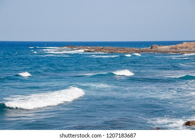 Sea with beautiful waves with white foam.