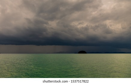 Sea before the storm. Clouds with strong wind, rain on the horizon. A tropical hurricane during the monsoon season in the subtropics of Thailand. View from sailing yacht on instantly changing weather
