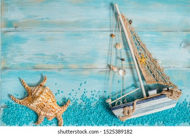 Sea blue salt from dead sea, shell in cosmetics set for spa on a blue old background. Wooden boat and shells. top view copy space. Sea spa and vacation concept