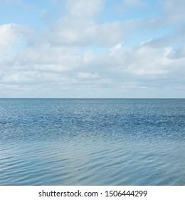 Sea blue water, horizon, clouds