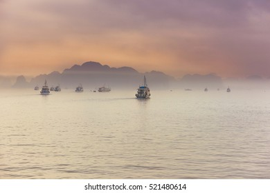 Sea Boats at the evening sunset, mountains background, Ha Long, Vietnam