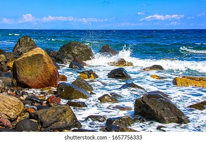 Sea boulders beach waves crashing. Sea waves crashing at boulders