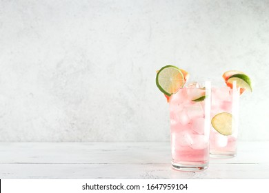 Sea Breeze Cocktail or Paloma Cocktail with grapefruit, lime and ice cubes, copy space. Summer brunch refreshing citrus cocktails.