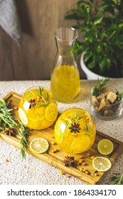 Sea buckthorn iced tea or lemonade with lime, rosemary, star anise and chia seeds. Tropical refreshing cold drink for summer