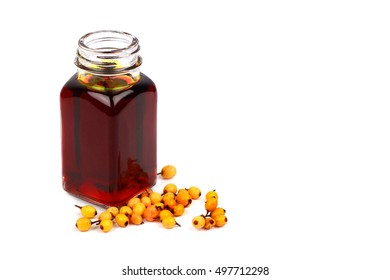 Sea buckthorn oil and berries on white background