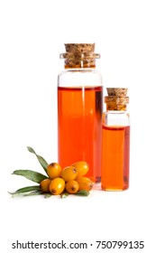Sea buckthorn and two bottles with sea buckthorn oil isolated on white background