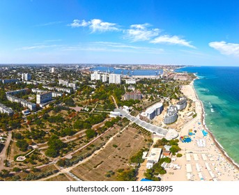 a sea city with a beach and a port