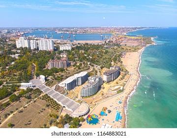a sea city with a port and a beach