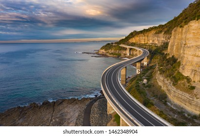 Sea Cliff Bridge at dawn.  The 665 metre long Sea Cliff Bridge is a highlight along the Grand Pacific Drive at Coalcliff NSW. The bridge is an icon for locals and for many thousands that visit anually