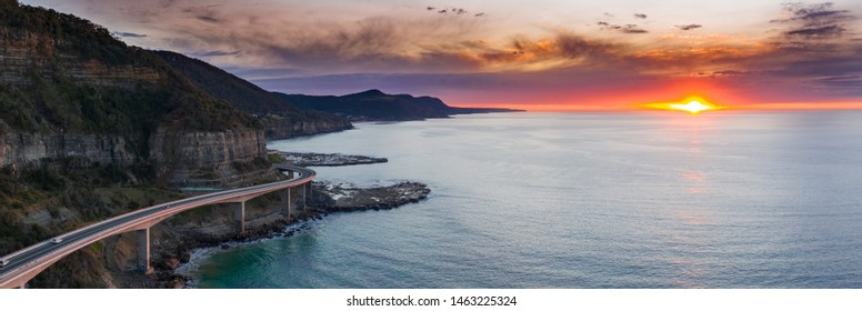 Sea Cliff Bridge at dawn. The 665 metre long Sea Cliff Bridge is a highlight along the Grand Pacific Drive at Coalcliff NSW. The bridge is an icon for locals and for many thousands that visit annually