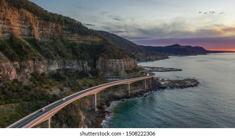Sea Cliff Bridge at dawn.  The 665 metre long Sea Cliff Bridge is a highlight along the Grand Pacific Drive at Coalcliff NSW.
