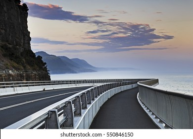 Sea Cliff Bridge on Grand Pacific drive in NSW, Australia, at sunset. Empty modern road along pacific coast from Sydney to Wollongong.