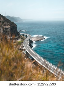 Sea Cliff Bridge on a sunny day from a lookout point