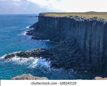 Sea ?basalt cliff and island