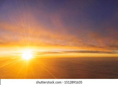 the sea of cloud sunset sky background from window airplane