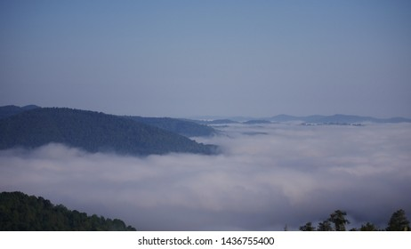 A sea of clouds betwixt mountains