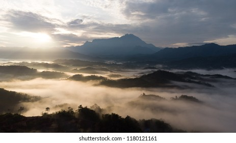 Sea of clouds during sunrise with Mount Kinabalu as background