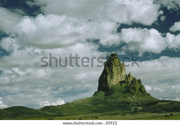 Sea of clouds over a lone rocky spire