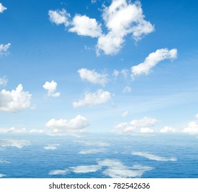 Sea clouds reflected in water