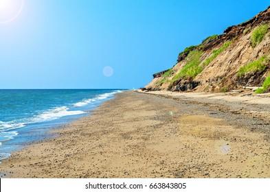 sea coast by a hot summer day