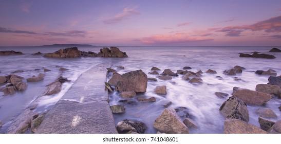 Sea Coast Sea Rocks Beatiful sunset on the rocks long exposure of sea and rocks, Hawk Cliff, Forty Foot, County Dublin  Blackrock - Dun Laoghaire - 40 Foot - Dalkey - Killiney