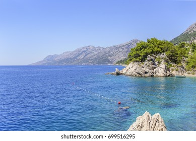 Sea coast with rocky coast. Brela, Croatia