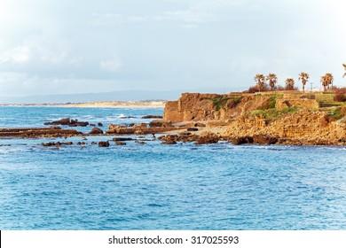 Sea Coast and Ruins of Caesarea Maritima before Sunset, Israel