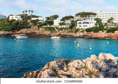 Sea coast scenery with blue turquoise waters and  rocky coast in Majorca island. Spain vacations concept.