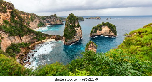 Sea coast view with little house standing on the high cliff bring above sea and little rocky islets. Atuh beach, Nusa Penida island. Popular travel destination on Bali holidays. Indonesian background.