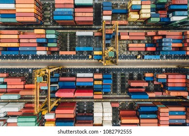 sea containers does not contain visible brand names or logos. Industrial port crane loading import and export Containers box in a Cargo container ship,
