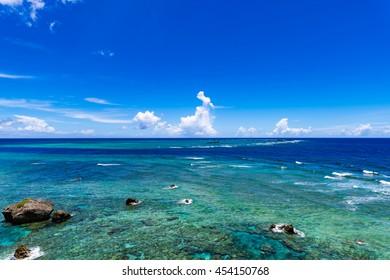 Sea, coral reef, sky, landscape. Okinawa, Japan, Asia.