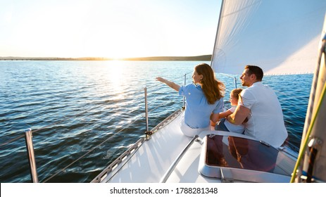 Sea Cruise. Family Sitting On Yacht Deck Sailing Across The Sea On Summer Vacation. Panorama, Copy Space