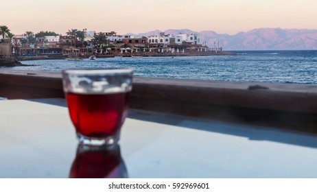 Sea at Dahab with a cup of black tea as the foreground.