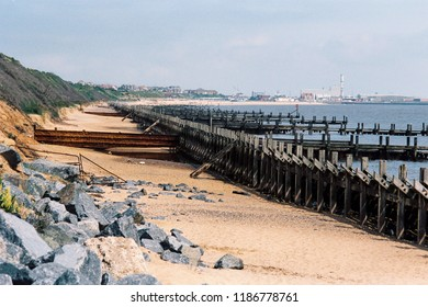 Sea defences between Gorleston and Hopton on the coast of Norfolk, England, with Gorleston beach and town in the distance