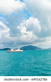 Sea ferry pass near highlands and hilly green island. Samui, Thailand