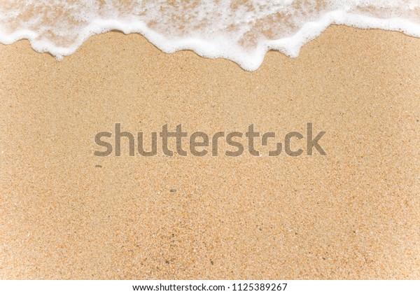 Sea Foam on the Sand Background Image