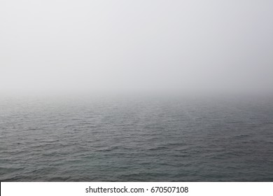 The sea in the fog. The line of the horizon, dissolving in the fog