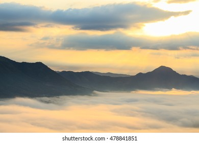 Sea of fog and mountain during sunrise, Thailand.