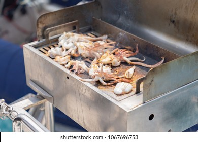 Sea food is squid barbecue cooking on luxury yacth, vacation holidays concept BBQ yacht paryty in the sea, luxury summer cruise.