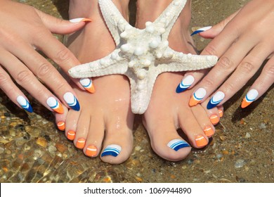 Sea French manicure and pedicure with a starfish on the coast in the summer in Sunny weather.