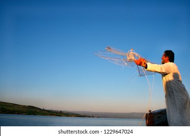 Sea of Galilee, Israel, fisherman, dressed as Saint Peter, casts a net March 5, 1998