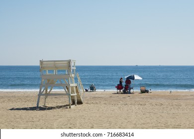 SEA GIRT, NEW JERSEY - September 15, 2017: People enjoy the beach on one of the last days of summer