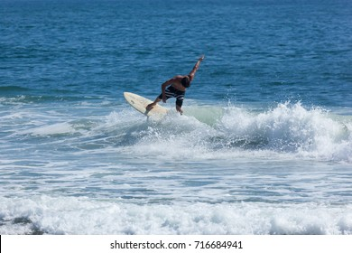 SEA GIRT, NEW JERSEY - September 15, 2017: Surfers enjoy a warm, sunny day as Summer comes to a close