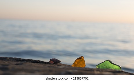 sea glass and shell with ocean , beach and seascape