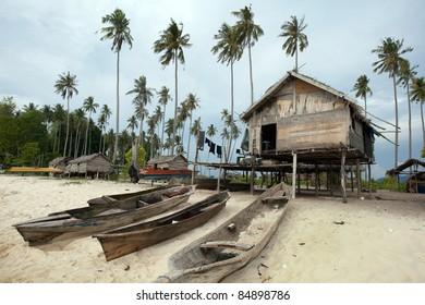 Sea gypsy cottage home on a desolated island off the Borneo Island coast.