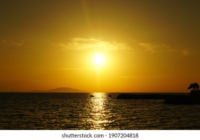 Sea horizon line at the beautiful golden and beige color tone sea sunset
