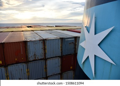At sea / Indian Ocean - September 09 2019: Large, fully loaded container ship, owned by Maersk Line, sailing through the Indian Ocean. View on the funnel and aft deck loaded with containers.