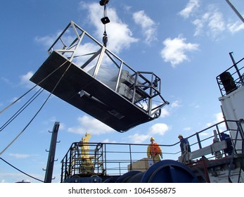 The Sea of Japan / Russia - December 01 2013: Epibenthic sledge lifted with the vessel crane