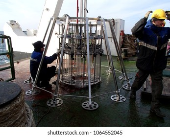 The Sea of Japan / Russia - November 30 2013: Science expedition team prepearing the multi core sampler to launch for deepwater sampling